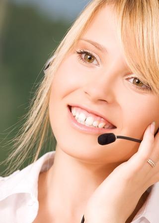 bright picture of friendly female helpline operator Stock Photo - 5348393