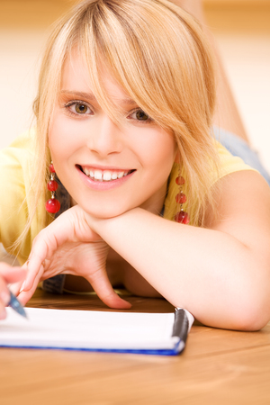 picture of teenage girl with notebook and pen Stock Photo - 5349404