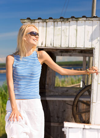 striped vest: picture of happy woman in striped vest on ship board LANG_EVOIMAGES