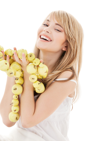 bright picture of lovely blonde with green apples Stock Photo - 5348274