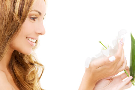 happy woman with white madonna lily flower Stock Photo - 5348528