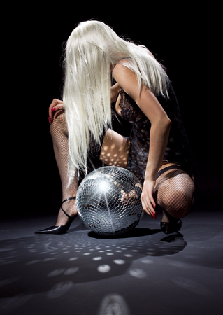 party dancer girl in fishnet stockings with disco ball Stock Photo - 5348502