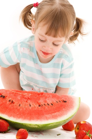 picture of little girl with strawberry and watermelon Stock Photo - 5348586