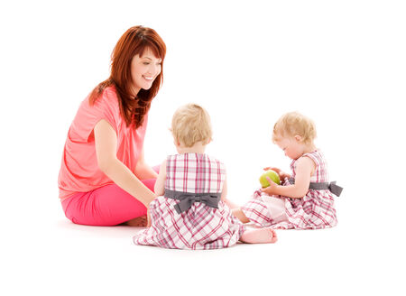 picture of two adorable twins with mother over white Stock Photo - 5348176