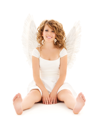 barefeet: picture of happy teenage angel girl over white