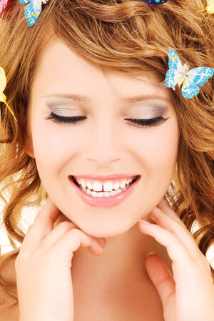 picture of teenage girl with butterflies over white Stock Photo - 5349443