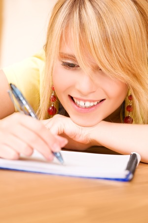 picture of teenage girl with notebook and pen Stock Photo - 5348607