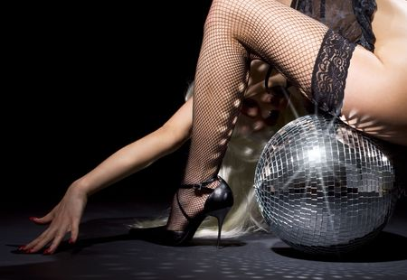 party dancer girl in fishnet stockings with disco ball Stock Photo - 5429774