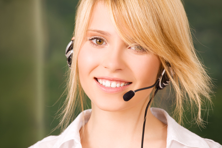 helpdesk: bright picture of friendly female helpline operator