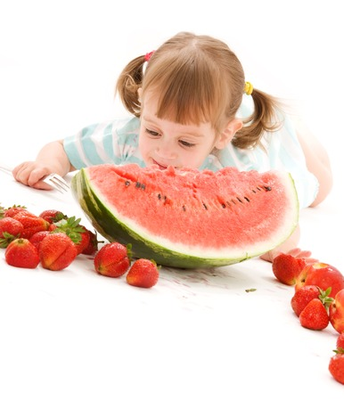 picture of little girl with strawberry and watermelon Stock Photo - 5668875