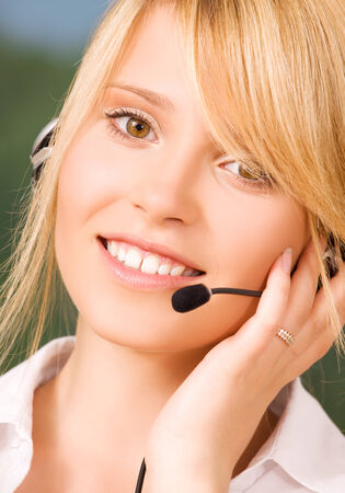 bright picture of friendly female helpline operator Stock Photo - 5685188