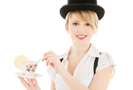british girl: bright picture of lovely girl with cup of tea
