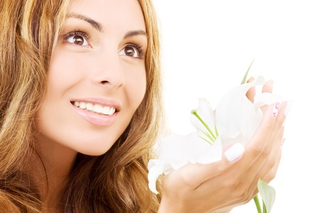 happy woman with white madonna lily flower Stock Photo - 5685271
