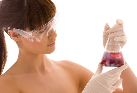 closeup of beautiful lab worker holding up test tube Stock Photo - 5676952