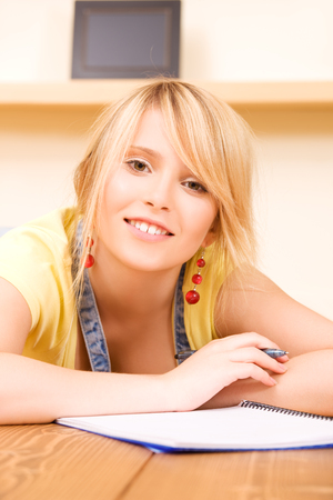 picture of teenage girl with notebook and pen Stock Photo - 5685130
