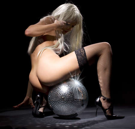 naked female: party dancer girl in fishnet stockings with disco ball