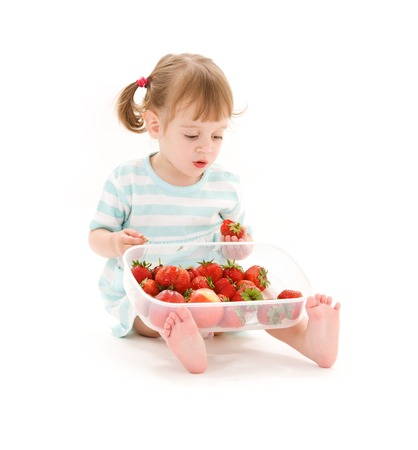 picture of little girl with strawberry over white Stock Photo - 5668738
