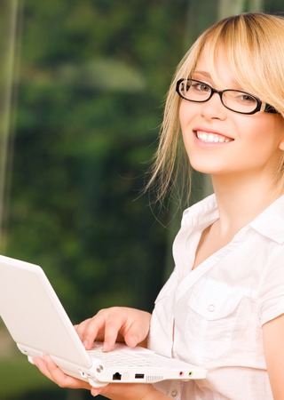 picture of office girl with laptop computer Stock Photo - 5668610