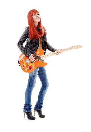 picture of lovely redhead girl with orange guitar Stock Photo - 5668790