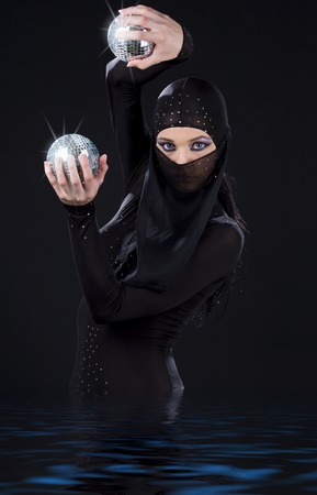 party dancer in ninja dress with disco balls Stock Photo - 5677139