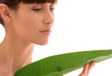 picture of woman with green leaf over white Stock Photo - 5668946