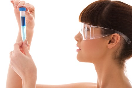 beautiful female lab worker holding up test tube Stock Photo - 5676962