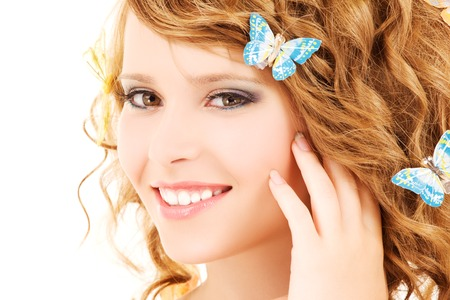 picture of teenage girl with butterflies over white Stock Photo - 5685377
