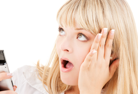 picture of surprised woman with cell phone Stock Photo - 5684993