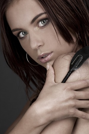picture of beautiful woman with riding crop Stock Photo - 5685246