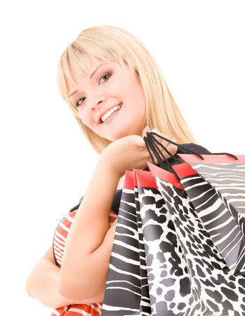 happy plus size woman with shopping bags over white Stock Photo - 5668916