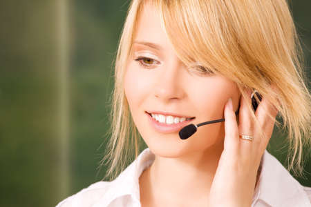 bright picture of friendly female helpline operator Stock Photo - 5685152