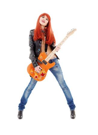 guitarra sexy: Fotograf�a de una ni�a pelirroja encantadora con la guitarra de color naranja