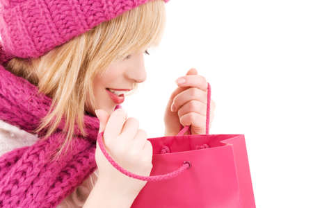 happy teenage girl in hat with pink shopping bags Stock Photo - 5677228