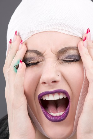 picture of screaming wounded woman face over grey Stock Photo - 5685144