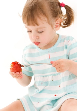 picture of little girl with strawberry over white Stock Photo - 5677077