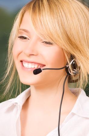 bright picture of friendly female helpline operator Stock Photo - 5685367