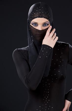 hidden danger: picture of ninja woman in the dark