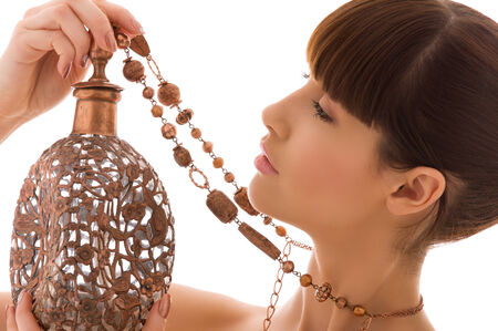 portrait of lovely woman with ancient copper jug Stock Photo - 5677041