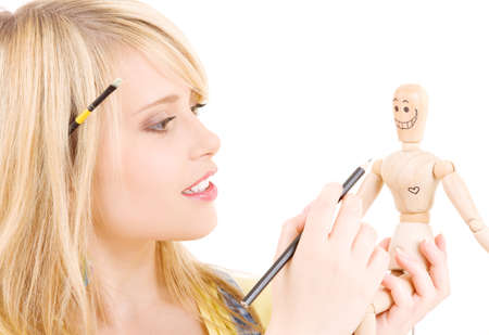 happy teenage girl with wooden model dummy over white Stock Photo - 5677023