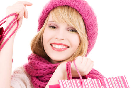 happy teenage girl in hat with pink shopping bags Stock Photo - 5685214