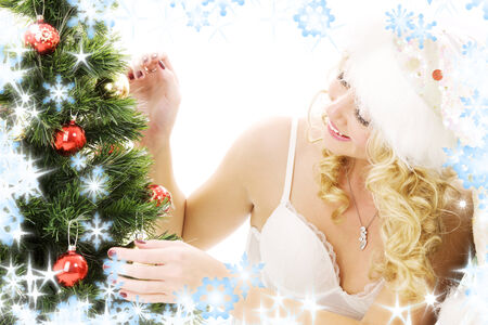 lovely santa helper girl decorating christmas tree Stock Photo - 5685299