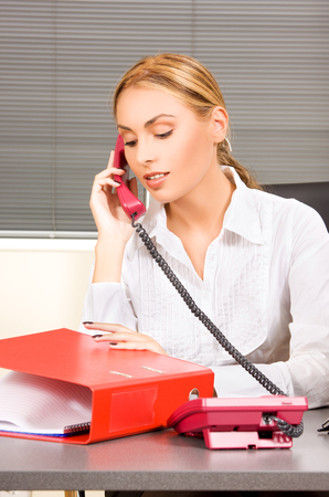 picture of lovely girl with phone in office Stock Photo - 5685004