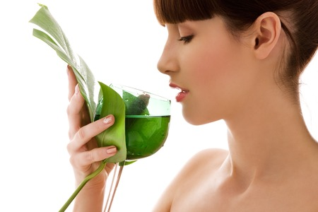 green drink: picture of woman with green leaf and glass of water