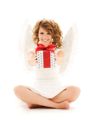 picture of happy teenage angel girl with gift over white Stock Photo - 5668802
