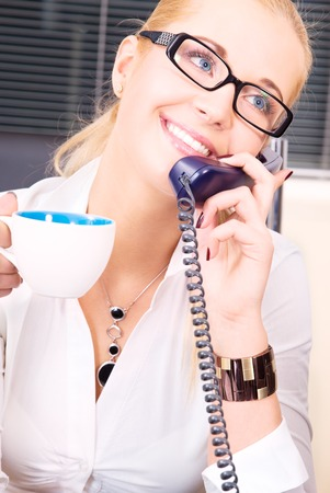picture of lovely girl with phone and cup of coffee Stock Photo - 5677167