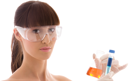 closeup of beautiful lab worker holding up test tubes Stock Photo - 5668793