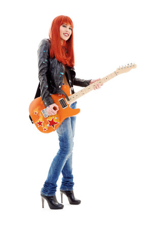 picture of lovely redhead girl with orange guitar Stock Photo - 5668751