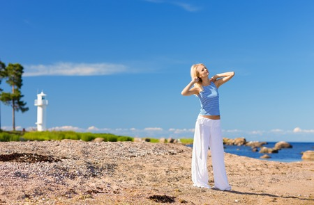 happy woman in striped vest on the seashore Stock Photo - 5685330