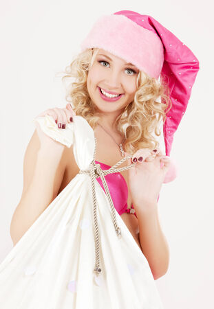 picture of cheerful santa helper girl with big bag Stock Photo - 5677203