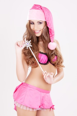 sexy santa helper girl with magic wand Stock Photo - 5677184